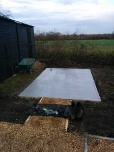Painted greenhouse base, but no greenhouse - yet.